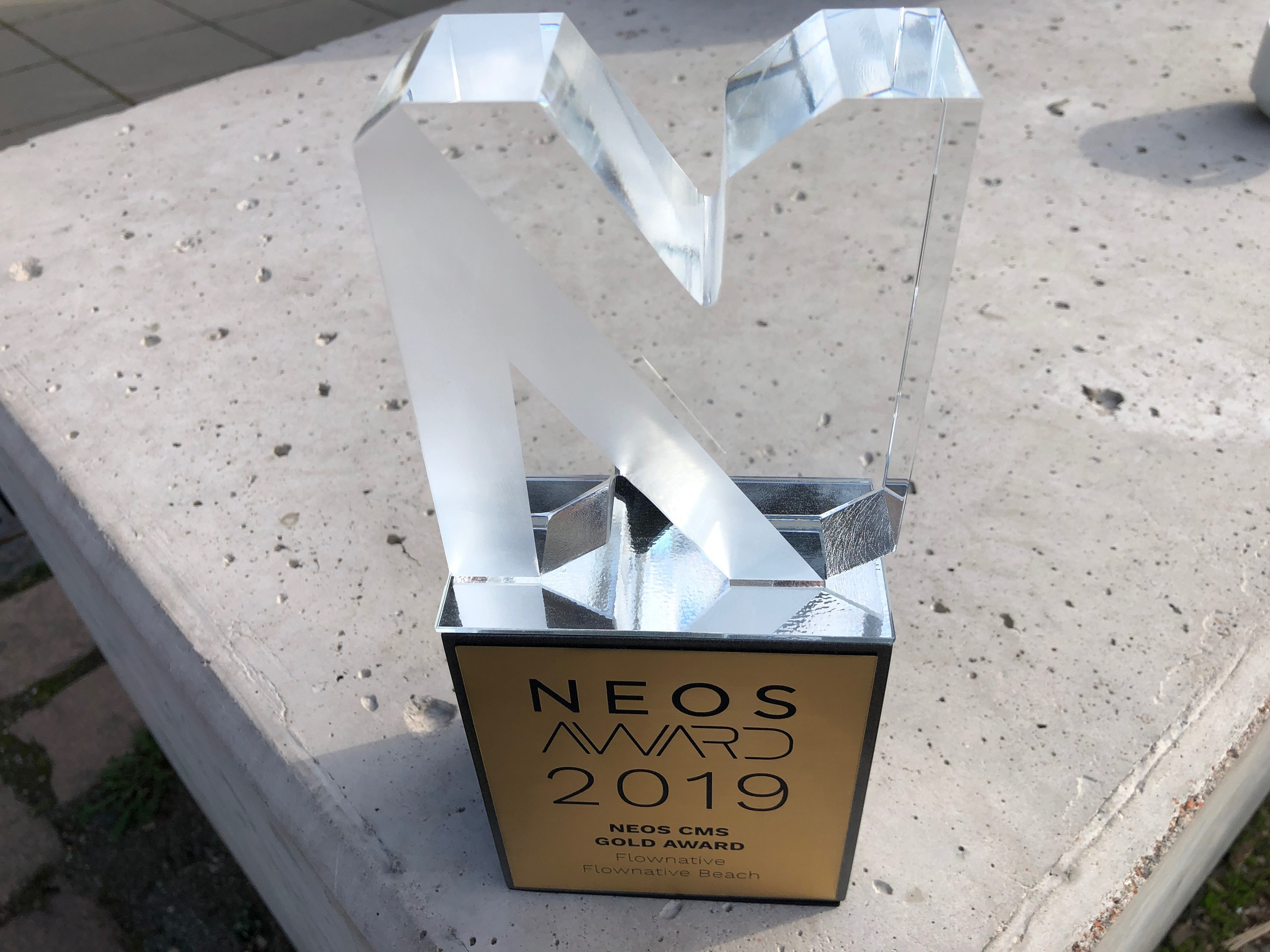 The Neos CMS Gold Award trophy